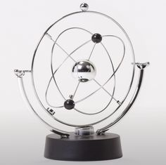 The base holds a battery-powered motor that spins a powerful magnet, which in turn exerts a variable force on the pendulum weight attached to the outer...
