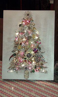 Vintage Jewelry Crafts I finally made my jewelry tree out of a lot of my mother in law's and mother's old costume jewelry. by shawna Jeweled Christmas Trees, Christmas Tree Art, Christmas Jewelry, Vintage Christmas, Christmas Decorations, Handmade Christmas, Christmas Ideas, Christmas Inspiration, Tree Decorations