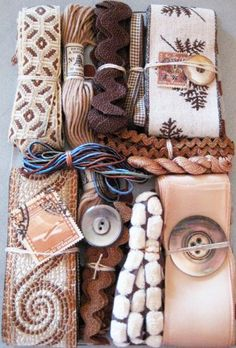 Collection of cream, peach, and brown ribbons, trims, and other notions