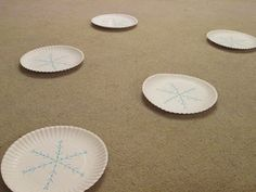"""Frozen Musical Snowflakes Party Game- one plate marked """"summer"""" and that person """"melts"""" and game goes on to next round until one player left."""