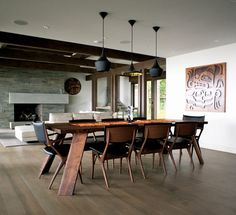 Woodvalley styled by Gaile Guevara #dining #room #set - Custom walnut dining table in collaboration with Christian Woo, Dining Room Chairs in walnut and black leather provided by Kozai, Tom Dixon pendants and artwork by Sabina Hill.