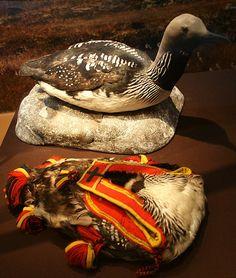 The magical feathers of the diver or loon bird used to make a purse for the shaman hammer. Storlommens magiske fjær. Ble brukt av noen nojder for at de dødes ånder ikke skulle ta plass i hans sjel. Vesken ble brukt som oppbevaring av tromme-hammeren og to | by saamiblog