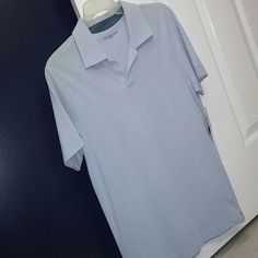 Men's Light Blue Polo Calvin Klein mens polo in light blue. Size small. Brand new with tags but noticed there is a slight stain on right side chest (shown in last pic). Tags still attached! Calvin Klein Tops Tees - Long Sleeve