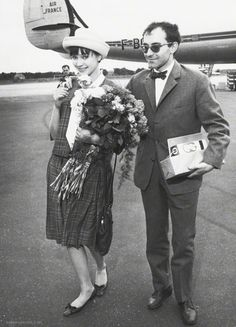 Anna and Jean-Luc Godard arrive in Germany for the Berlinale, 1961.
