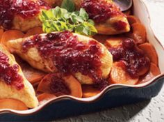 """Cranberry Roast Chicken and Sweet Potatoes Recipe - """"Looking for an easy (yet still special) alternative to a traditional holiday meal? This chicken is a great choice! We love the flavor... and just how darn simple it is to prepare!"""""""