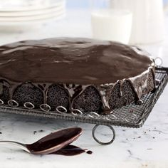 Basic Chocolate Cake - OK Making dessert for company so will make this and then ice it with Tiramisu Mascarpone cheese spread.  Then I will top it with fresh blueberries, raspberries, and shaved white chocolate.  Beautiful.