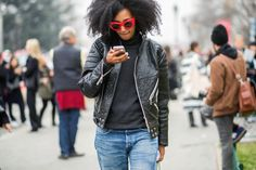 Relaxed boyfriend jeans, textured leather jacket and bright sunglasses at Paris Fashion Week // street style photo: The Styleograph