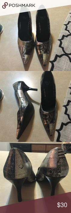 BKE heels, never worn outdoors. Pair of BkE heels, 3 inch heels. In great shape, never worn outdoors. Been sitting in my closet for quite some time. Will consider all reasonable offers! BKE Shoes Heels