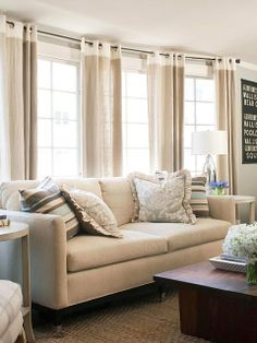 love the linen curtains defined by the white stripe and grommets at the top!