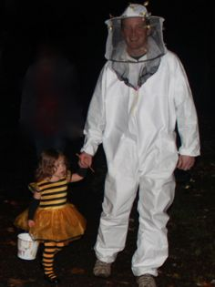 My little bee.  She makes a beekeeper's job easy!  I think I rocked the beekeeper's get up, if I do say so myself.  ; ) Let's just say I was the only Dad in town IN costume.