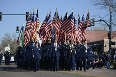 Members of Fort Carson, Cheyenne Mountain Air Force Station and Schriever and Peterson Air Force Bases participate in the Colorado Springs Veterans Day Parade Nov. 8, 2014, in Colorado Springs, Colo. (Air Force Photo/Christopher DeWitt)