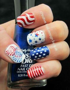 Patriotic Nail Art Consisting Of Stars, Stripes And Pattern Paint