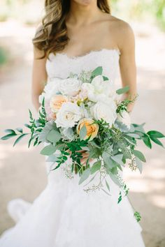 Lamb's ear, peony, rose, and eucalyptus wedding bouquet: Floral Design: Vanda Floral Design - http://www.stylemepretty.com/portfolio/vanda-floral-design Wedding Dress: Monique Lhuillier - https://www.moniquelhuillier.com/ Photography: This Love of Yours Photography - thisloveofyours.com   Read More on SMP: http://www.stylemepretty.com/2016/11/04/outdoor-sonoma-county-sophisticated-film-winery-wedding/