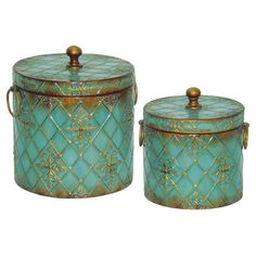 2 metal canisters with a diamond motif against a distressed teal background.  Product: Small and large lidded canister  C...