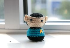 """Everyone's favorite half-Vulcan looks a little...fuzzier. :) Crocheted with an E-sized hook using acrylic yarn, filled with polypellets to weigh it down and polyfil to fluff it up! Head and body are adapted from this free pattern for Ogilvy dolls, with a pair of pointy ears attached! Pattern for Spock's pointy ears can be found here (scroll down to where it says """"single leaf""""). *Note: The ears in the photo don't use this pattern, but I've used the above pattern for later Spocks that..."""