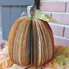 Whether you go for scary stories or happy endings, this upcycled-book pumpkin prop will add some literary allure to your seasonal stoop. #etsyfinds