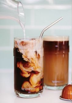 Watch two indulgent flavors combine into one delicious drink with this recipe for Iced Salted Caramel Latte. Grand Cru Caramelizio from Nespresso enhances the classic notes. Mini Desserts, Plated Desserts, Hot Coffee, Coffee Drinks, Iced Coffee, Frozen Coffee, Iced Latte, Fresh Coffee, Sweet Coffee