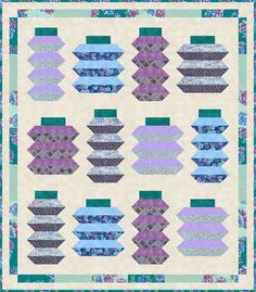 Lanterns designed by Robert Kaufman Fabrics. Features Imperial Collection by Studio RK, shipping to stores March 2017. Roll-up friendly. Three color stories (Black, Indigo, Jewel). FREE pattern will be available for download in March 2017 from robertkaufman.com#FREEatrobertkaufmandotcom