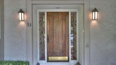 Solid front door with side lights