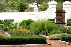 Walled garden with gravel paths and wood edging.