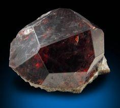 Almandine-Spessartine Garnet. Location of mineral deposit: Shigar Valley, Skardu District, Gilgit-Baltistan (Northern Areas), Pakistan.