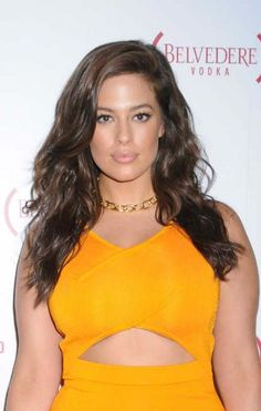 Ashley Graham looked radiant and absolutely gorgeous as usual as she opted to dress up in a bright yellow dress with a curve hugging design, a cut out panel over her midsection and a bit long hemline that hit at her shins, while posing for the cameras on the red carpet at the Belvedere (RED) campaign 10 year celebration on August 28, 2016 at the Apollo Theater in New York City. Other notable attendee at the event was singer John Legend.