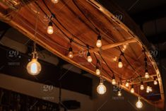 Vintage wooden Canoe hanging from ceiling with Edison lights in lodge stock photo Lakehouse Restaurant, Canoe Restaurant, Gazebo Lighting, Edison Lighting, Ceiling Hanging, Hanging Lights, Ceiling Lights, Wood Canoe, Knights Hospitaller