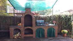 2015 End of Summer Photo Contest Entry - Outdoor Kitchen with Wood Fired Pizza Oven. What Fun!!!