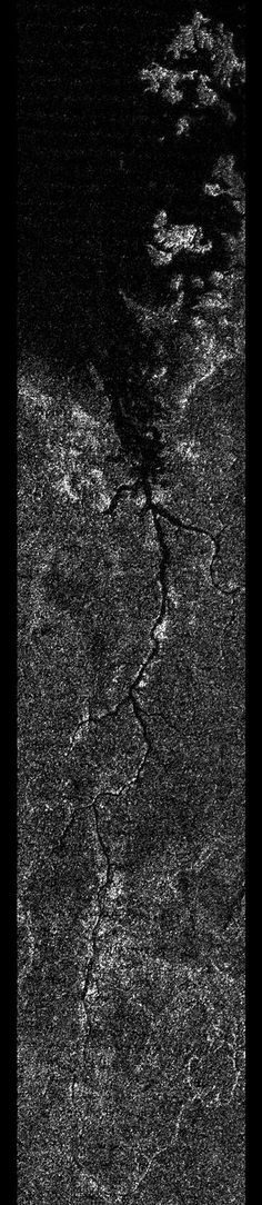 New image shows 200 mile-long liquid river on Titan Evan AckermanWednesday, December 12, 2012 Planetary scientists have suspected for quite a while that Titan, one of Saturn's moons, has a 'methane cycle' that's much like the water cycle we have here on Earth. New pictures from Cassini suggests that the similarity between Titan and Earth may be even more pronounced, as astronomers have identified a huge, Earth-like river system full of liquid methane.
