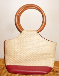 Vintage Etienne Aigner straw purse wood handles small handbag. Four inner compartments of which two are zippered compartments. Woven straw,
