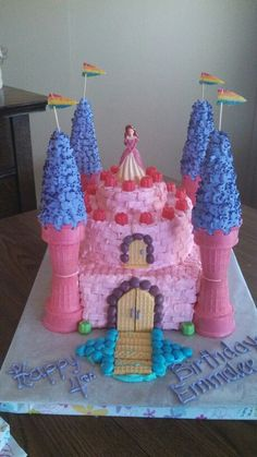 Castle cake with ice cream cone tower.