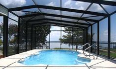Enhance your home with screen rooms, pool enclosures, and entry doors from Aluminum Contractors serving Lake, Sumter and Marion Counties. Pool Screen Enclosure, Screen Enclosures, Pool Enclosures, Entry Doors, Outdoor Decor, Room, Products, Home Decor, Bedroom