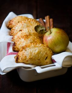 White Cheddar and Cinnamon Apple Hand Pies. a hand pie that is the perfect marriage of sweet and savory, tart and spiced and salty and sharp.  The dough flakes off like soft, lightly crisped shards of cheesy butter straight into your mouth, revealing an inside of warm, sweet, fruity apple pie filling, all topped off with a tiny bit of coarse sugar crunch sprinkled on the outside.