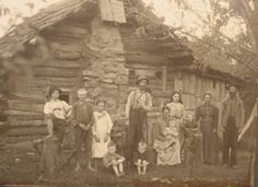 Vintage Photo of a Frontier Log Cabin Family