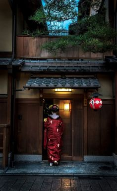 Japanese building front and red paper  lantern. and a Geisha.