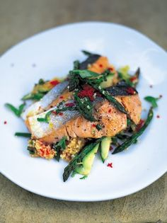 """""""This super-fresh salmon and couscous salad is a tasty, wholesome and quick dinner """" 