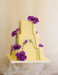 Beautiful purple flowers- I like the contrast with the yellow simple cake