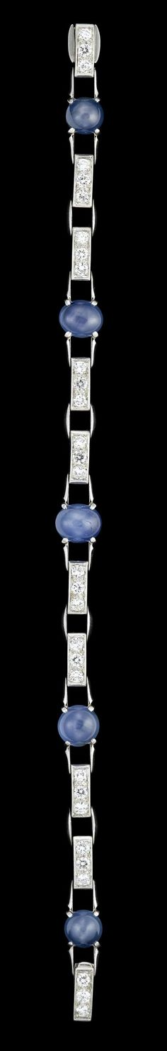 Platinum sapphire and diamond bracelet, JE Caldwell & Co.   1940s   Five graduated blue cabochon star sapphires prong set separated by ten platinum and diamond panels, total diamond weight approximately 1.4 carats.