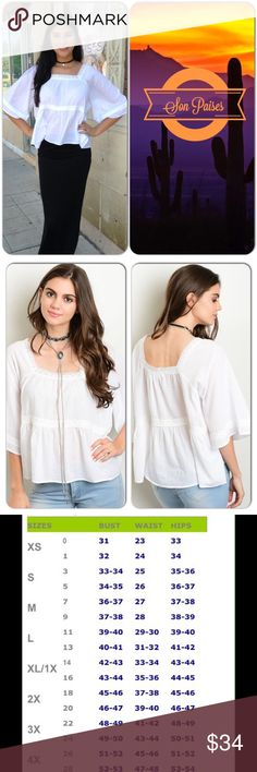 Bohemian Crochet Accented Top This bohemian style white two tier top with crochet accented panels and quarter sleeves. Nice comfy cotton material. (This closet does not trade or use PayPal) Loveriche Tops Blouses