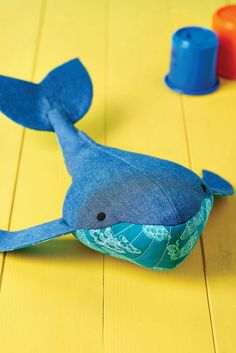 This friendly whale by Cheryl Owen is the perfect companion and proves a great way to recycle old jeans. Choose a bright contrast fabric for the belly and underside of the fins and tail. You'll be riding the waves in no time!