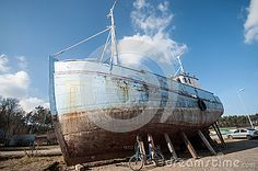 Old fisher ship wreck in port of Ustka, Poland