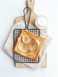 Preheat oven to 200ºC (390ºF). Place the apple, sugar, cinnamon and butter in a small bowl and mix to combine. Cut the pastry into 4 equal squares and score the edges to create a 1cm border. Layer with the apple mixture and brush with the egg.