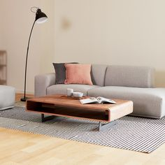 The Peri Coffee Table is a compact and simple piece. It is designed to         sit low to the ground and is supported by dove gray metal legs. The         blade legs are also powder coated for extra resilience. The high grade         walnut veneer is wrapped around the Peri Coffee Table fully, showcasing         the amazing craftsmanship of our manufacturers. Home Living Room, Apartment Living, Dining Room Furniture, Home Furniture, Stainless Steel Table Top, Online Furniture Stores, Walnut Veneer, Living Room Inspiration, Bathroom Interior Design