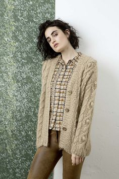 The cardigan is knitted with a double strand of yarn.