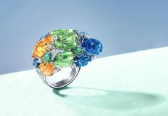 Étourdissant Cartier. Pushkar Ring - white gold, carved mandarin garnets, carved tsavorite garnets, carved tanzanites, cabochon-cut black opals, brilliant-cut diamonds.
