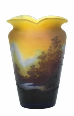 A small vase,  Gallé, Nancy, c. 1906/14, the colourless glass partially cased in ochre yellow, overlaid in light blue and dark violet and decorated with an acid etched mountainous lakeside landscape, frosted ground, the flaring body of circular section and with an oval two-lobe rim, with acid etched signature Gallé towards the bottom, height 13.7 cm