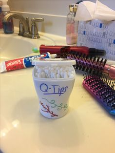 Recycle an empty gum container into a storage unit for q-tips