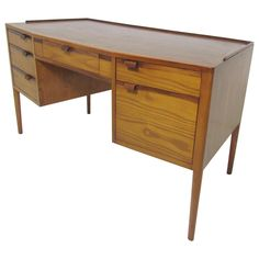 Rosewood Desk with Leather Top by Edward Wormley for Dunbar | From a unique collection of antique and modern desks and writing tables at https://www.1stdibs.com/furniture/tables/desks-writing-tables/