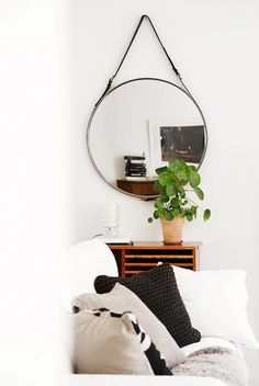 A Round Belted Mirror.By attaching some affordable leather belts from H&M to a round mirror from IKEA, one crafty Swede create a totally luxurious looking glass.