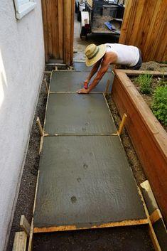Fresh dog prints in our new DIY Concrete Pavers! Large Concrete Pavers, Concrete Pathway, Diy Concrete Patio, Paver Walkway, Diy Patio, Backyard Patio, Walkways, Pavers Patio, Concrete Paver Mold